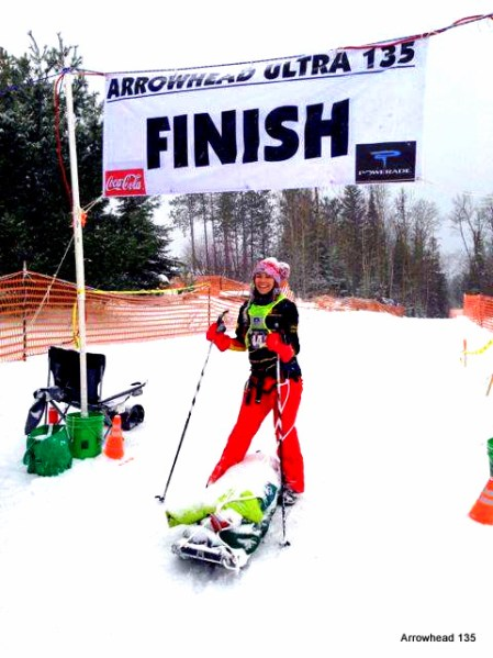 Minnesota's Kari Anne Gibbons brightens the finish with her friend: the green pulk