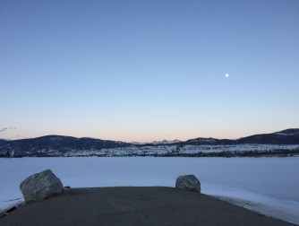 Serene moonrise over Dillon Reservoir.