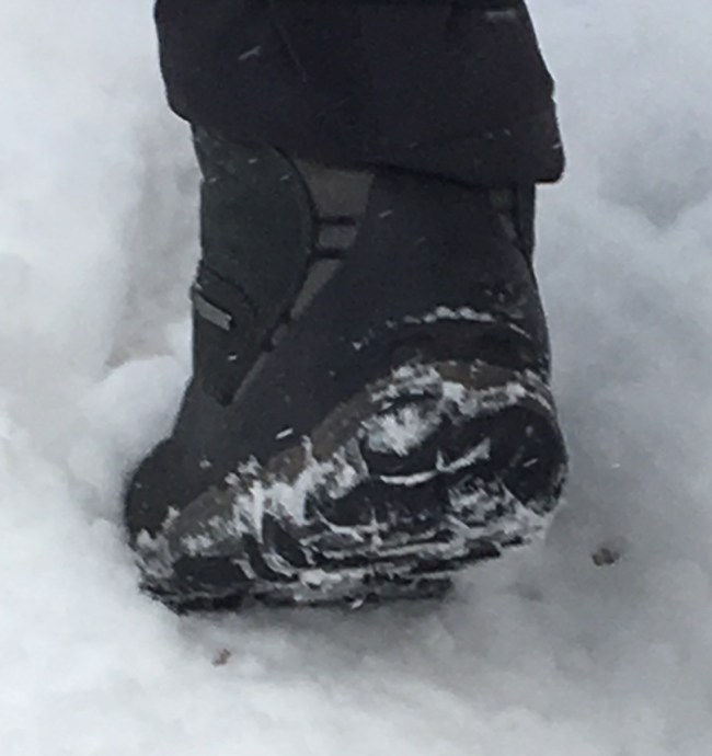 close up of the Oboz Bridger boot and outsole in snow