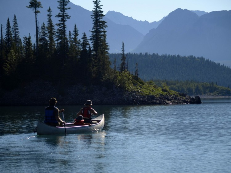 family kayaking in Peter Lougheed Provincial Park