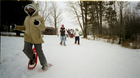 snowshoeing health benefits: students running on snowshoes