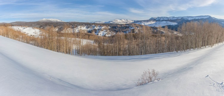 panorama with snow in foreground and mountains in back