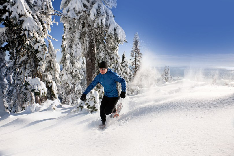 man running in the snow at Grouse Mountain