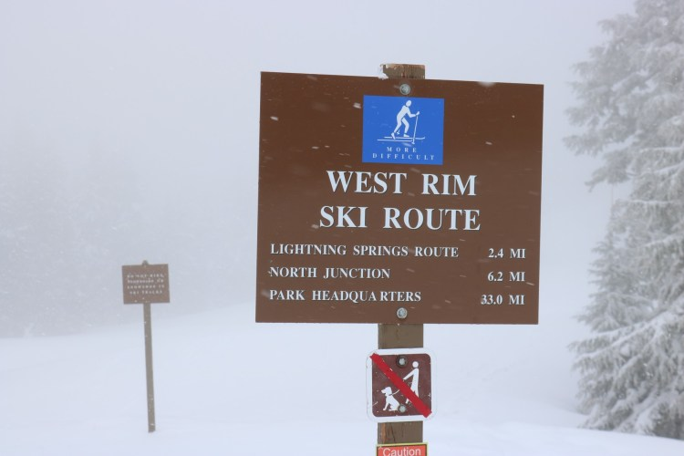 Crater Lake National Park winter: trail sign at West Rim Drive in cloudy conditions