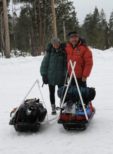 Stan and Margaret in front of their two sleds in Yellowstone