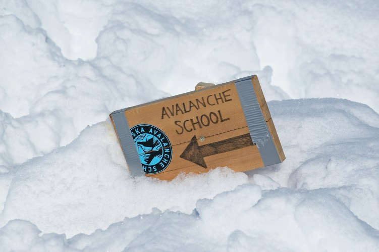 avalanche school sign in the snow