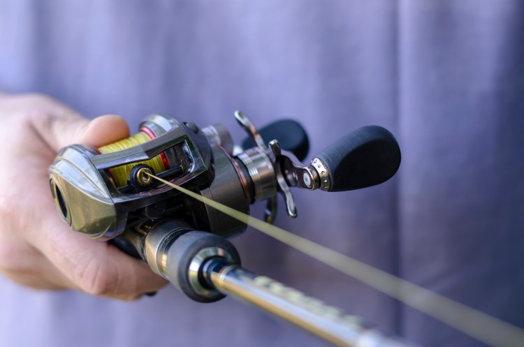close up of baitcasting reel for winter fishing