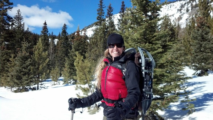 woman smiling on winter hike