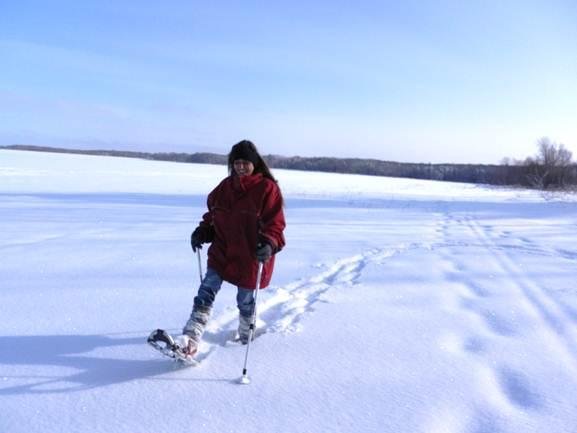 Snowshoeing along the Big Eau Pleine Reservoir in the flatlands of Wisconsin.