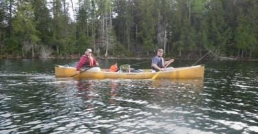 two men in canoe on Whitefish Lake