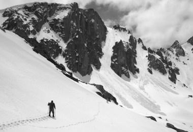 man snowshoeing near avalanche terrain
