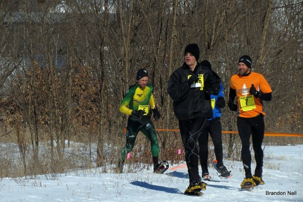 """Fierce racing action clearing the woods for a """"U-shaped"""" dash to the line. Robert Bolton (6) gets by the group and Jordan Neeck (not pictured, 15th) for 14th, while Jason Bond (7)  edges ahead of Kris Borchardt (106) for 16th by three seconds. Hidden, Ryan Albu finished 17th for the age-class silver while Borchardt took its gold."""