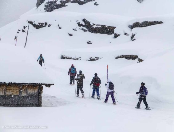 """""""First"""" time - a group of British students trying snowshoeing"""