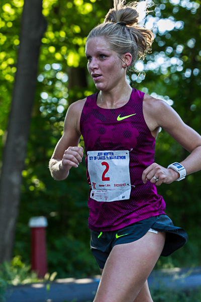 Olympian Lisa Uhl setting a new state record while wearing the best looking watch in the race