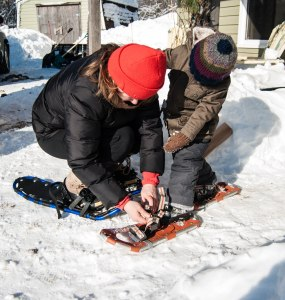 Always eager to learn, Jack watches me strap on his new snowshoes.