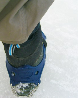 Rear view of the Hillsound Trail Crampon Ultra. Similarly to snowshoe bindings, a boot design incorporating a rear notch goes a long way towards keeping the rubber uppers from sliding down.