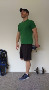 standing quad stretch : stretches for snowshoeing