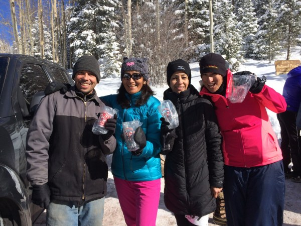 Participants in the 2016 Santa Fe Snowshoe Classic show off their well-deserved pint glasses.