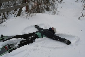 One of their favorite things to capture on film, Mommy doing a snow angel