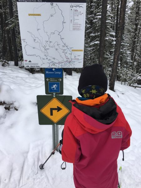 Looking at trail sign