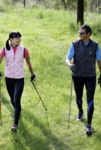 Enjoying a sunny Nordic walk together, from http://nordicwalking.co.uk
