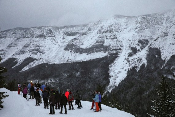 Snowshoers on top of the mountain, Castle Mountain Resort tour in Alberta