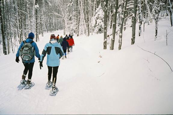 Snowshoeing in the hills of Stowe Vermont.