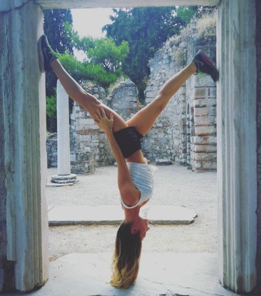 girl inverted on a doorway
