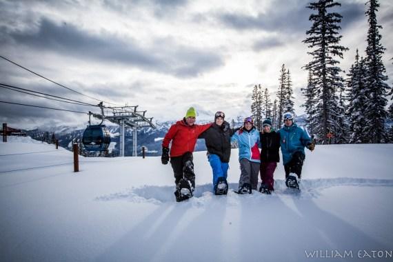 snowshoers near ski lift on snowshoe tour at Revelstoke Mountain Resort, British Columbia