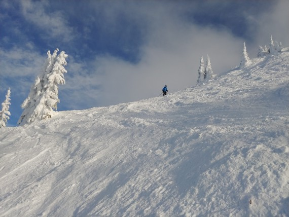 snowshoeing with a blue sky at Revelstoke Mountain Resort