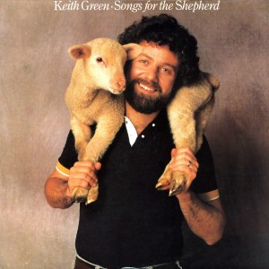 Christian Music album cover of Songs for the Shepherd by Keith Green. It is a photo of a smiling Keith Green holding a lamb on his shoulders, which wraps around his head.