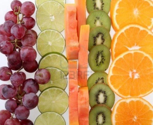15397365-sliced-lemons-kiwi-papaya-orange-and-grapes-online