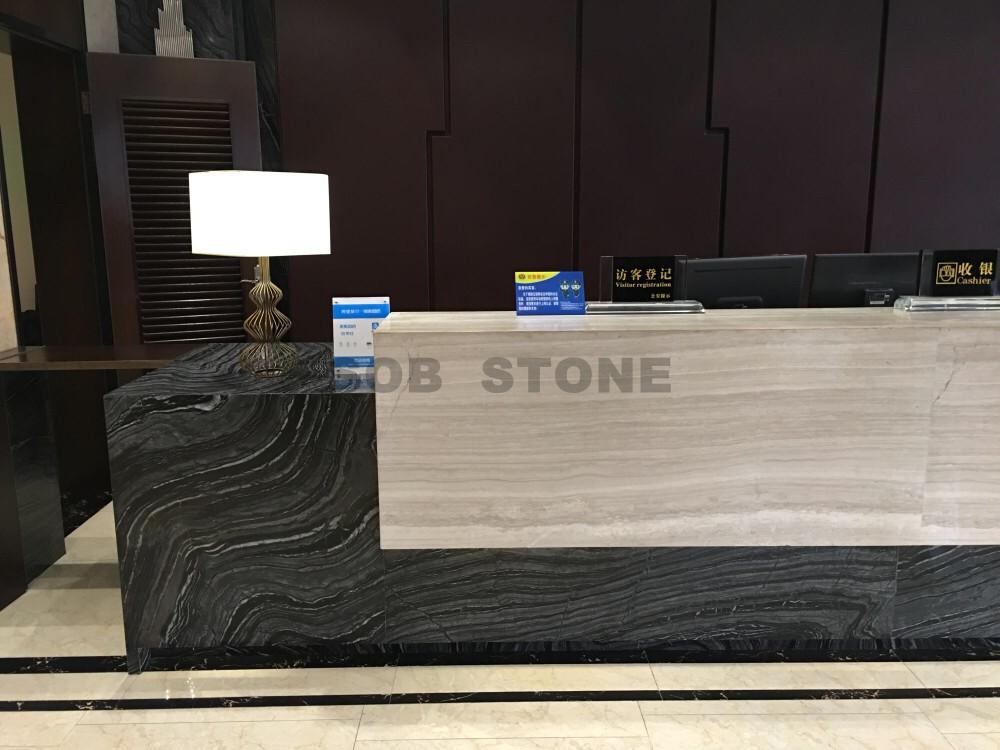 white wooden marble reception desk
