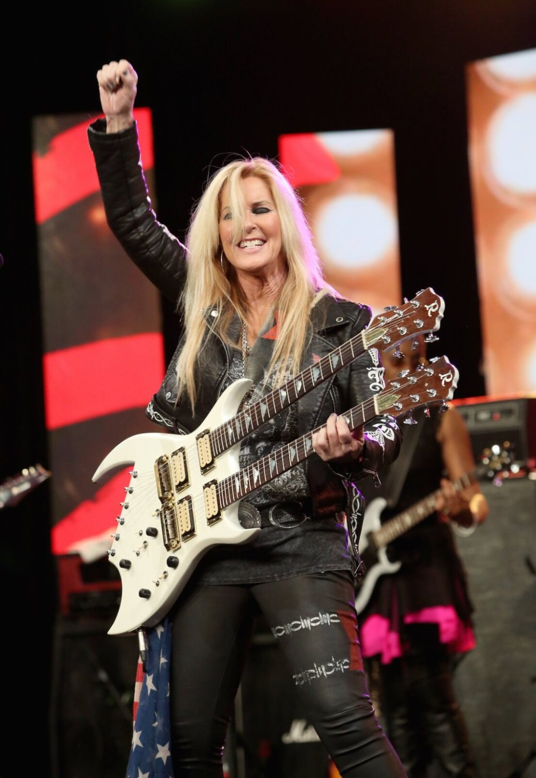 Guitarist Lita Ford performs on stage at the She Rocks Awards during the 2017 NAMM Show at the Anaheim Convention Center on January 20, 2017 in Anaheim, California. (Photo by Jesse Grant/Getty Images for NAMM)