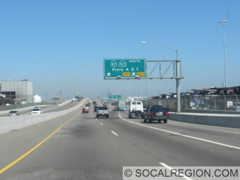 Exit signage for the southern end of the Terminal Island Freeway. 47 and 103 are signed at first.