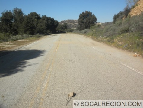 Section of former three-lane highway. This was bypassed in 1968.