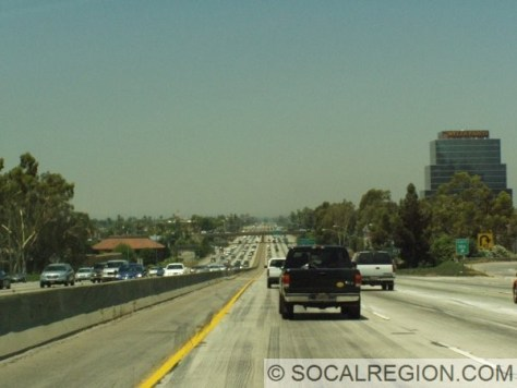 View of the San Bernardino Freeway near Holt Avenue, after leaving the Kellogg Hills. Looking west.