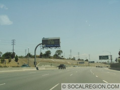 View northbound approaching SR-91, with the toll lanes at $2.30