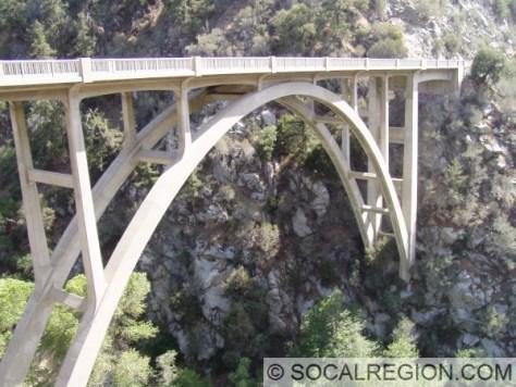 Open arch bridge over Mill Creek. Built in 1941.