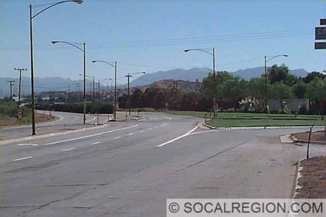 Shown here, an old alignment of SR-126 separates from the Old Road . This junction was the original location for Tip's Restaurant and was located directly in front of this photo. One of the largest Standard gasoline stations was once here as well. It was located just to the right of the photo.