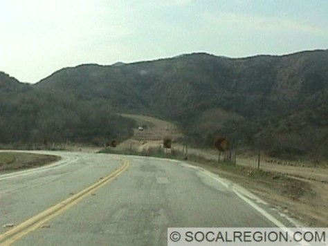 Los Angeles County realigned most of the upper part of San Francisquito Canyon Road but ran out of funding to complete a bypass of the narrowest and curviest segment. That segment also happens to pass by the remains of the St. Francis Dam. This section is now in use. The former section, heavily damaged by storms in January 2005, is closed off to vehicular use.