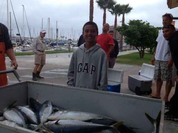 Adrian had his 14th birthday on the boat, and got his limit of 5 yellows.  No hook and hands!