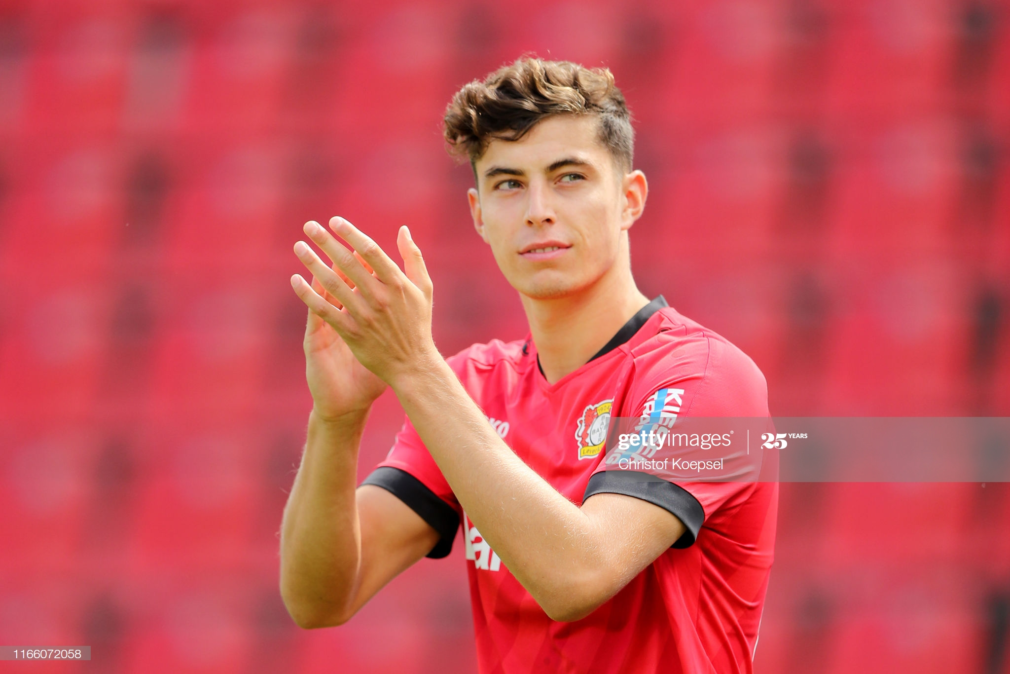 LEVERKUSEN, GERMANY - AUGUST 04: Kai Havertz of Leverkusen welcomes the fans during the opening show prior to the pre-season friendly match between Bayer 04 Leverkusen and FC Valencia at BayArena on August 04, 2019 in Leverkusen, Germany. (Photo by Christof Koepsel/Bongarts/Getty Images)