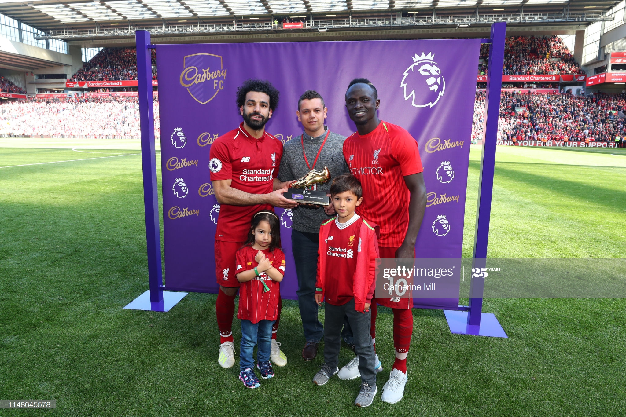 LIVERPOOL, ENGLAND - MAY 12: Mohamed Salah of Liverpool and Sadio Mane of Liverpool pose with the golden boot trophy after the Premier League match between Liverpool FC and Wolverhampton Wanderers at Anfield on May 12, 2019 in Liverpool, United Kingdom. (Photo by Catherine Ivill/Getty Images)