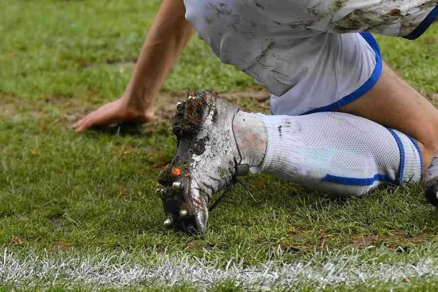Soccer player on muddy ground