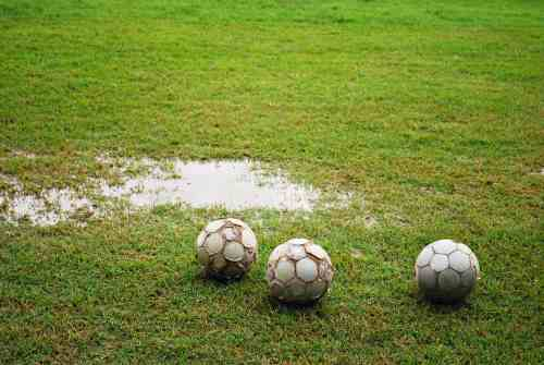 clean soccer cleats - muddy field