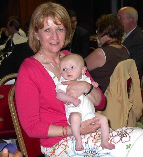 Bev Hughes Minister for Children with baby Oscar