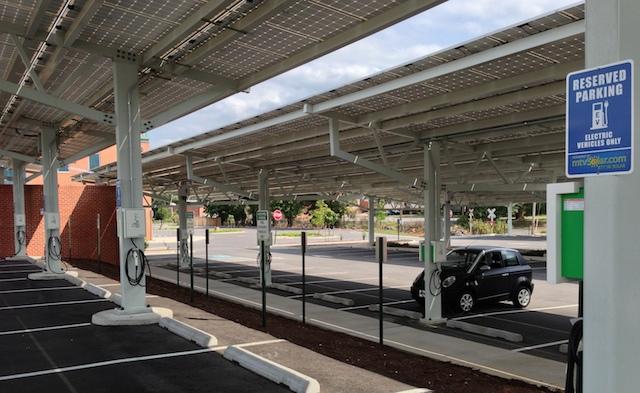 Electric car charging under APUS Solar Canopy Parking Lot