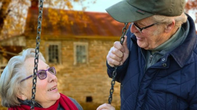 An elderly couple symbolise the process of ageing.