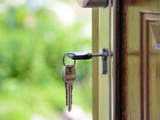 Image of housekeys in a wooden door